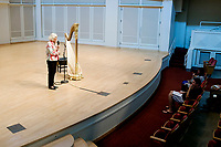 USA International Harp Competition Founder and Artistic Director Susann McDonald introduces harpist Lenka Petrovic for Petrovic's laureate recital during the 11th USA International Harp Competition at Indiana University in Bloomington, Indiana on Sunday, July 7, 2019. (Photo by James Brosher)