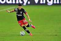 WASHINGTON, DC - SEPTEMBER 27: Joseph Mora #28 of D.C. United passes off the ball during a game between New England Revolution and D.C. United at Audi Field on September 27, 2020 in Washington, DC.