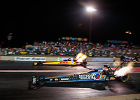 Jul 19, 2019; Morrison, CO, USA; NHRA top fuel driver Antron Brown (near) races alongside Richie Crampton during qualifying for the Mile High Nationals at Bandimere Speedway. Mandatory Credit: Mark J. Rebilas-USA TODAY Sports