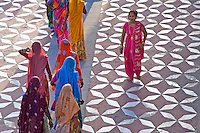 Visiting the The Taj Mahal in Agra,India Women from Jodhpur in Rajasthan in their traditional colorful dress creating a spectacle in design and color in contrast to the white Marble of the Taj