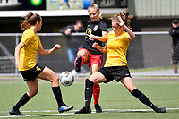 Lara Wall of Canterbury competes for the ball with Hope Gilchrist of Capital during the ISPS Handa Women's Premiership - Capital Football v Canterbury Utd Pride at Petone Memorial Park, Wellington on Saturday 5 December 2020.<br /> Copyright photo: Masanori Udagawa /  www.photosport.nz