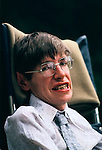 Stephen Hawking portrait at  family home 1980s UK Cambridge.