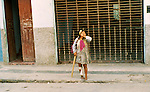 Poor woman on homemade Crutch, wounded leg, Peru
