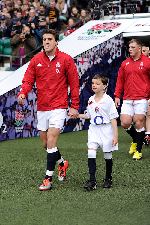 England captain Lee Dickson leads the team out during the match between England and Barbarians at Twickenham Stadium on Sunday 31st May 2015 (Photo by Rob Munro)