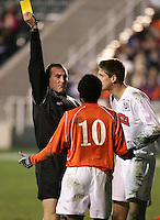 Referee Terry Vaughn (l) issues yellow cards to both Clemson's Dane Richards (10) and New Mexico's Andrew Boyens (r) at 64:59. The University of New Mexico Lobos defeated the Clemson University Tigers 2-1 in a Men's College Cup Semifinal at SAS Stadium in Cary, NC, Friday, December 9, 2005.