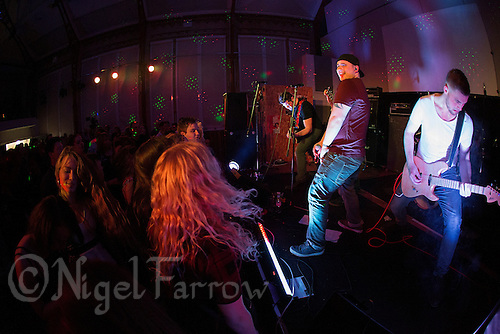 10 Jan 2015 - STOWMARKET, GBR - Sam Robson of Renegade Twelve on vocals, flanked by Dan Potter (left) and Jake Mayes (right) performs at the John Peel Centre for Creative Arts in Stowmarket, Suffolk, Great Britain (PHOTO COPYRIGHT © 2015 NIGEL FARROW, ALL RIGHTS RESERVED)