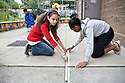 Madrona K-8 School in Seattle, WA: Seth Bundy's 8th-grade math students, working in chalk outside, show their understanding of geometrical concepts.