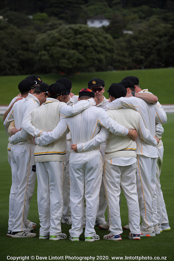 The Firebirds huddle during day one of the Plunket Shield match between the Wellington Firebirds and Otago at Basin Reserve in Wellington, New Zealand on Thursday, 5 November 2020. Photo: Dave Lintott / lintottphoto.co.nz