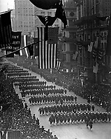 Sailors from Pelham Bay Naval Training Station marching down Fifth Avenue in the Fourth Liberty Loan Parade, New York City.  1918.  Paul Thompson.  (War Dept.)<br />Exact Date Shot Unknown<br />NARA FILE #:  165-WW-235D-2<br />WAR & CONFLICT BOOK #:  512
