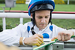 Jockey Brett Prebble who rode Contentment sign autographs while poses for photos after winning the Champions Mile (1600m) on 07 May 2017, at the Sha Tin Racecourse  in Hong Kong, China. Photo by Chris Wong / Power Sport Images