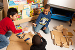 Education Preschool 4 year olds 3 boys playing activity with human figures