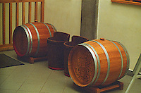 "At the Oremus winery, Tolcsva, Tokaj: Two ""puttonyos"" baskets and two gönci casks. Traditionally the number of puttonyos on a bottle signifies how many baskets have been added to one cask. Today this is no longer so. Now it is a question of must weight. Oremus is owned by the Alvarez family that also owns Vega Sicilia in Spain It is managed by Andras Bacso. Credit Per Karlsson BKWine.com"
