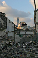 A skyscraper is framed in the rubble of what was once a home in one of the many condemned areas of Old Town in Shanghai, China. Daily life is changing drastically for thousands in China as old neighborhoods are torn down to make way for new, modern structures..
