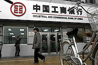 People walk past an Industrial & Commercial Bank of China branch in Beijing, China. .