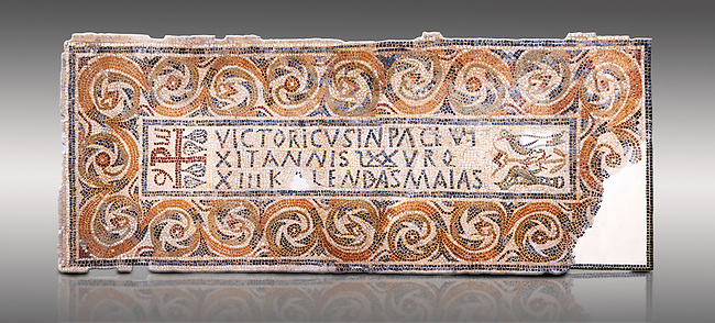 """Fifth century Eastern Roman Byzantine  Christian funerary mosaic dedicated to Leontia.  The Constantinian monogram depicting the Christian Chi-Rho symbol used by the Roman emperor Constantine I as part of his military standard (vexillum).  The inscription in the cartouche reads """" Leontia in peace and harmony with God, entered into eternal life on the Sixth Ides of October"""". Two birds and cut Roses occupy the rest of the mosaic. <br /> <br /> Excavated from Demna Parish Church ruins between the 4th and 5th columns of the right aisle. The Bardo National Museum, Tunis, Tunisia."""