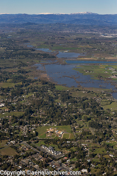 aerial photograph of Sebastopol toward Windsor and the snow covered Mayacamas mountains, Sonoma County, California