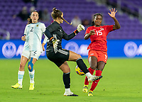 ORLANDO, FL - FEBRUARY 21: Laurina Oliveros #12 of Argentina collides with Nichelle Prince #15 of Canada during a game between Canada and Argentina at Exploria Stadium on February 21, 2021 in Orlando, Florida.