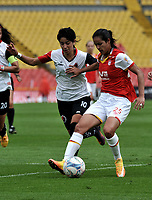 BOGOTA - COLOMBIA - 07 - 05 - 2017: Lady Andrade (Der.) jugadora de Independiente Santa Fe disputa el balón con Fany Gauto (Izq.) jugadora de Cucuta Deportivo, durante partido de la fecha 10 entre Independiente Santa Fe y Cucuta Deportivo, por la Liga Femenina Aguila 2017, en el estadio Nemesio Camacho El Campin de la ciudad de Bogota. / Lady Andrade (R) jugadora of Independiente Santa Fe struggles for the ball with Fany Gauto (L) player of Cucuta Deportivo, during a match of the date 10 for the Liga Femenina Aguila 2017, between Independiente Santa Fe and Cucuta Deportivo, at the Nemesio Camacho El Campin Stadium in Bogota city, Photo: VizzorImage / Luis Ramirez / Staff.