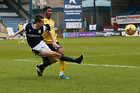 20th February 2021; Dens Park, Dundee, Scotland; Scottish Championship Football, Dundee FC versus Queen of the South; Isaiah Jones of Queen of the South can't stop Cammy Kerr of Dundee firing in a cross