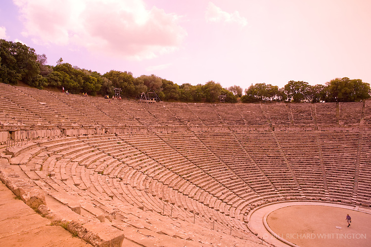 The Epidaurus Theatre was designed by Polykleitos the Younger in the 4th century BCE. The theatre is renowned for its excellent acoustics, which are often demonstrated on tours by someone dropping a penny on the stage and the people on the 55th row being able to hear it perfectly.