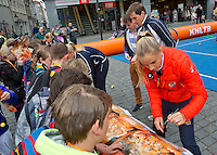 April 17, 2015, Netherlands, Den Bosch, Maaspoort, Fedcup Netherlands-Australia,  Arantxa Rus  (NED) signing  aurographs<br /> Photo: Tennisimages/Henk Koster