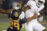 BERKELEY, CA - September 17, 2016: California's (29) Khalfani Muhammad attempts to tackle Texas' Kris Boyd on a at Cal Memorial Stadium.