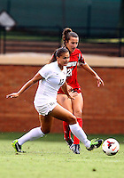 WINSTON-SALEM, NORTH CAROLINA - September 01, 2013:<br />  Devyn Ciotti (21) of Louisville University moves up on Katie Stengel (12) of Wake Forest University during a match at the Wake Forest Invitational tournament at Wake Forest University on September 01. The match was abandoned early in the second half due to severe weather with Wake leading 1-0.