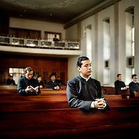 Young priests pray in the chapel at the Legionaries of Christ seminary in Salamanca. The Legion of Christ is a conservative Roman Catholic congregation whose members take vows of chastity, obedience and poverty. They pray four times everyday.