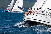 Yachts racing in strong winds during the final leg of the Tahiti Pearl Regatta, from Tahaa Island in the lagoon to Raiatea
