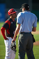 Batavia Muckdogs manager Angel Espada (4) argues a call with umpire Emil Jimenez during the second game of a doubleheader against the Auburn Doubledays on September 4, 2016 at Dwyer Stadium in Batavia, New York.  Batavia defeated Auburn 6-5. (Mike Janes/Four Seam Images)