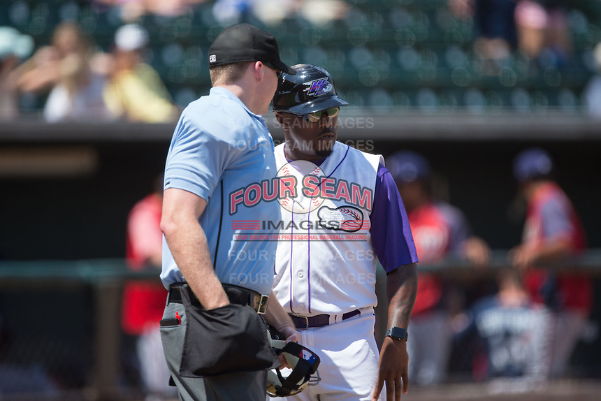 Winston-Salem Dash manager Willie Harris (1) discusses a call with home plate umpire Thomas Roche during the game against the Potomac Nationals at BB&T Ballpark on August 6, 2017 in Winston-Salem, North Carolina.  The Nationals defeated the Dash 4-3 in 10 innings.  (Brian Westerholt/Four Seam Images)