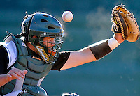 15 April 2008: University of Vermont Catamounts' catcher Jeff Nolet, a Junior from Concord, MA, takes a hit to the face-mask during a game against the Dartmouth College Big Green at Historic Centennial Field in Burlington, Vermont. The Catamounts rallied from a 7-3 deficit going into the bottom of the ninth, to tie and then win in the tenth: 8-7 over Dartmouth in a non-conference NCAA game...Mandatory Photo Credit: Ed Wolfstein Photo