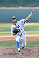 Max Schuh #45 of the UCLA Bruins pitches against the Cal Poly Mustangs at Jackie Robinson Stadium on February 22, 2014 in Los Angeles, California. Cal Poly defeated UCLA, 8-0. (Larry Goren/Four Seam Images)