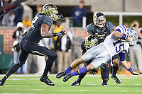 Kansas State quarterback Jake Waters (15) is sacked by Baylor linebacker Taylor Young (11) during an NCAA football game, Saturday, December 06, 2014 in Waco, Tex. Baylor defeated Kansas State 38-27. (Mo Khursheed/TFV Media via AP Images)