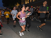 HALF MARATHON EARLY START<br />Runners take off Saturday Oct. 9 2021 at the 7 a.m. start of the 11th annual Run Bentonville Half Marathon. Some 2,100 runners registered for the half-marathon and 5-kilometer races, said David Wright, Bentonville parks and recreation director. The event was held on trails and streets in the city. The 2020 event was virtual. This year's half-marathon was originally set for last spring, but was postponed until Saturday. The 2022 event is scheduled for spring 2022, Wright said. Go to nwaonline.com/211010Daily/ to see more photos.<br />(NWA Democrat-Gazette/Flip Putthoff)
