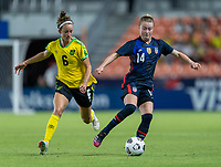 HOUSTON, TX - JUNE 13: Havana Solaun #6 of Jamaica defends Emily Sonnett #14 of the USWNT dribbles during a game between Jamaica and USWNT at BBVA Stadium on June 13, 2021 in Houston, Texas.