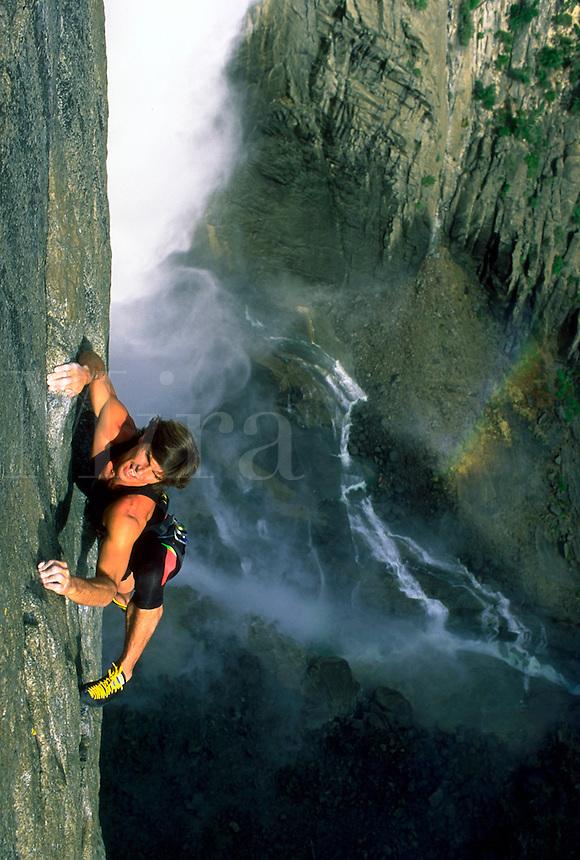 Aerial view of rock climber beside Yosemite Falls in Yosemite National Park, California.<br />