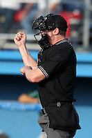 Home plate umpire Alex Tosi makes a call during a game between the Jamestown Jammers and Batavia Muckdogs at Dwyer Stadium on June 27, 2011 in Batavia, New York.  Batavia defeated Jamestown 4-3.  (Mike Janes/Four Seam Images)