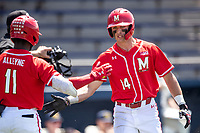 Maryland Terrapins outfielder Troy Schreffler (14) celebrates with his teammates against the Michigan Wolverines on May 23, 2021 in NCAA baseball action at Ray Fisher Stadium in Ann Arbor, Michigan. Maryland beat the Wolverines 7-3. (Andrew Woolley/Four Seam Images)
