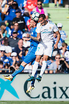 Lucas Vazquez Iglesias of Real Madrid (R) fights for the ball with Vitorino Gabriel Pacheco Antunes of Getafe CF (L) during the La Liga 2017-18 match between Getafe CF and Real Madrid at Coliseum Alfonso Perez on 14 October 2017 in Getafe, Spain. Photo by Diego Gonzalez / Power Sport Images