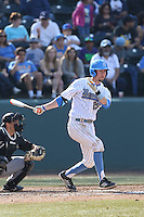 Chris Keck #25 of the UCLA Bruins bats against the Cal Poly Mustangs at Jackie Robinson Stadium on February 22, 2014 in Los Angeles, California. Cal Poly defeated UCLA, 8-0. (Larry Goren/Four Seam Images)
