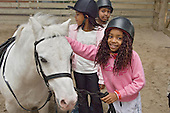 Children from the Stowe and Avenues youth clubs at a horse riding session at the Westway Sports Centre, West London