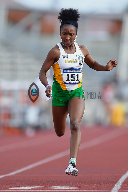Tiffani McReynolds of Baylor competes in 100 meter prelims during West Preliminary Track and Field Championships, Friday, May 29, 2015 in Austin, Tex. (Mo Khursheed/TFV Media via AP Images)