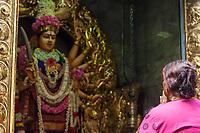 Singapore Hindu Temple Sri Vadapathira Kaliammam during Navarathiri Celebrations.  Woman Praying to Hindu Deity.