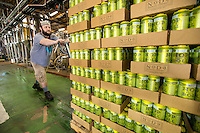 NoDa  Community - NoDa Brewing Company located on Davidson Street in the Charlotte's NoDa Community. Visitors to the brewery can sip on a cold brew while getting an insiders view of the stainless steel brew kettles and fermenters onsite.<br /> <br /> Brian Hondorf,  an employee at NoDa Brewing Company , wheels a new batch of batch of Hop, Drop 'N Roll IPA (India Pale Ale), to the shipping area at the NoDa company.<br /> <br /> <br /> Charlotte Photographer - PatrickSchneiderPhoto.com
