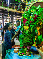 Parents Introducing Son to Hanuman Shrine, Sree Veera Hanuman Hindu Temple, Kuala Lumpur, Malaysia.