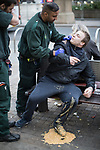 © Joel Goodman - 07973 332324 . 06/04/2017 . Manchester , UK . A paramedic tends to a man who has vomited over himself , on a bench on Piccadilly . An epidemic of abuse of the drug spice by some of Manchester's homeless population , in plain sight , is causing users to experience psychosis and a zombie-like state and is daily being witnessed in the Piccadilly Gardens area of Manchester , drawing large resource from paramedic services in the city centre . Photo credit : Joel Goodman