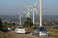 KENYA, Nairobi, Ngong Hills, 25,5 MW Wind Power Station with Vestas and Gamesa wind turbines, owned and operated by KENGEN Kenya Electricity Generating Company, view to Nairobi / KENIA, Ngong Hills Windpark, Betreiber KenGen Kenya Electricity Generating Company mit Vestas und Gamesa Windkraftanlagen, Blick nach Nairobi