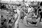Panama City, Florida<br /> March 2004<br /> Spring Break<br /> <br /> Hundreds of Young Americans party to the music as they drink the afternoon away screaming at the women who enter a wet-tee-shirt contest at the Club La Vela on the beach.