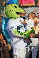 Daytona Tortugas mascot Shelldon the Tortuga holding a young fan before a game against the Tampa Yankees at Radiology Associates Field at Jackie Robinson Ballpark on June 13, 2015 in Daytona, Florida. Tampa defeated Daytona 8-6. (Robert Gurganus/Four Seam Images)